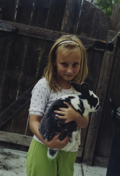 Holding a pet rabbit safely.