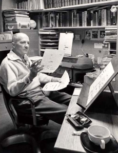 Robert A. Heinlein at his desk reading