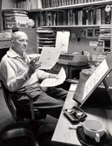 Robert A. Heinlein at his desk reading